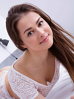 Nomy In A Mesmerizing Curly Brunette